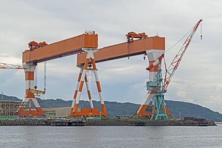 Two huge shipbuilding Gantry Cranes at the shipyard