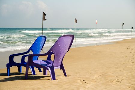 two chairs on the sea shore