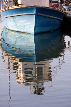 reflected blue boat , Jaffa, Israel