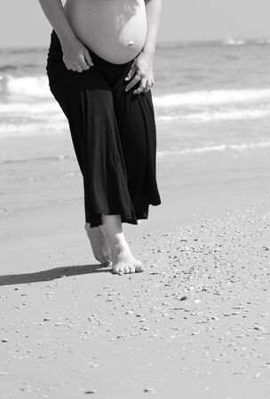 black and white of pregnant on the beach