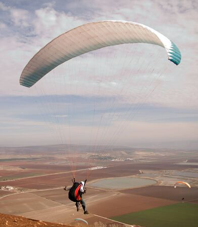 colorful paraglider flying in the sky