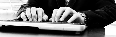 black and white picture of man working on computer on the office Stock Photo