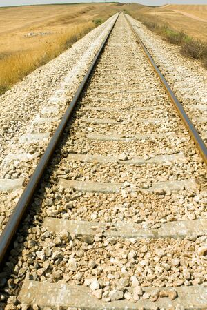 Railroad tracks curving off into the rural fieldsRailroad tracks curving off into the rural fields photo