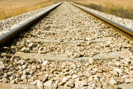 Railroad tracks curving off into the rural fields photo