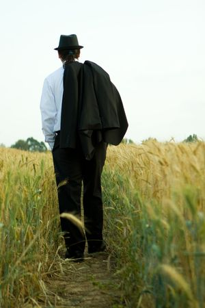 business man on the wheat field
