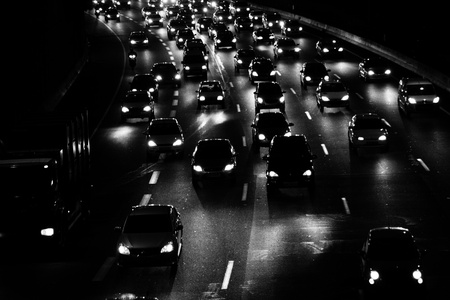 night traffic: black and white, high contrast image of the traffic jam at night
