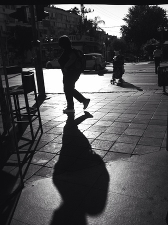 harsh light: High contrast black and white street photograph