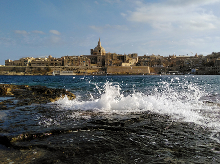 Malta Old city Valetta view with sea wave spalsh
