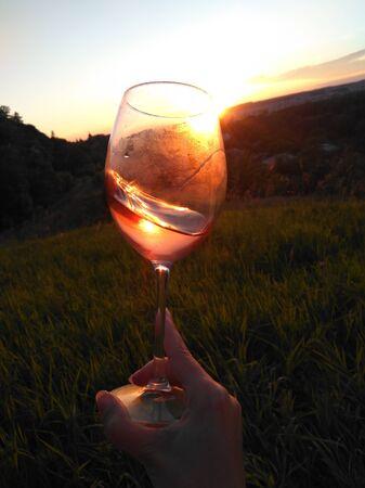Swirl wine outdoor with hand Stockfoto - 132104798