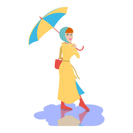 Young beautiful Woman with the umbrella walks on rainy day