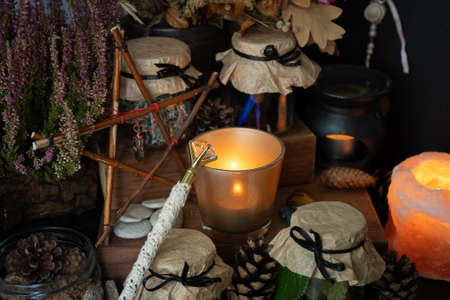 Magic wand with a crystal surrounded by pagan witchy objects. 写真素材