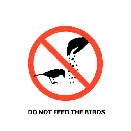 Prohibition sign with text do not feed the birds and hand silhouette giving food to sparrow