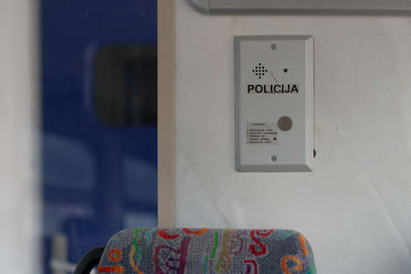 Latvia - 03.16.2020: interior view of train in Latvia. Police call button on the wall.