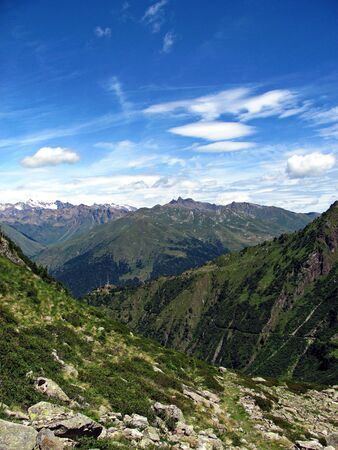 A view of and from the top of the mountains in a sunny summer day   Italian Alps landscape  - Ponte di legno   photo