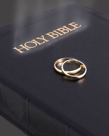 Holy bible glowing & wedding rings photo