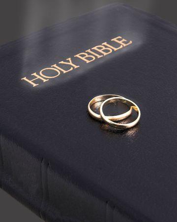 Holy bible glowing & wedding rings Stock Photo - 485664