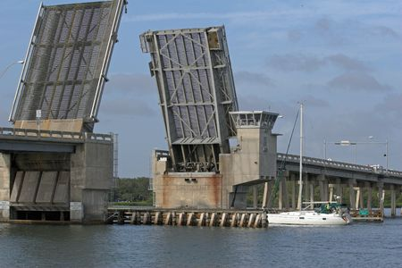 boat lift: Draw bridge at gulf of mexico in florida opening for boat traffic Stock Photo
