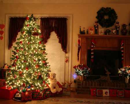 Home with lighted christmas tree, presents,fireplace,stockings photo