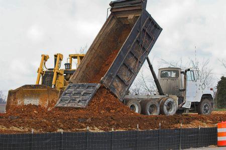 dumptruck: Large dozer & large dumptruck working together
