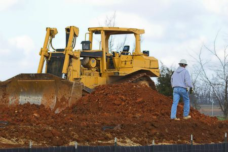 large dozer and worker waiting for second load of dirt Stock Photo - 505564