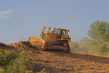 Heavy duty dozer shaping hill side  for new highway