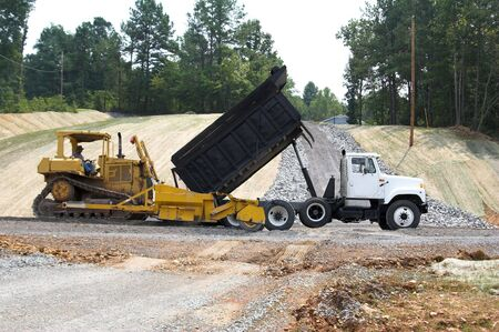 Dump truck delivered a load of crushed stone to new construction site