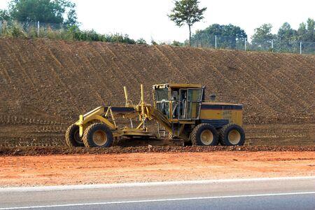 grader: Grader  leveling dirt for new highway