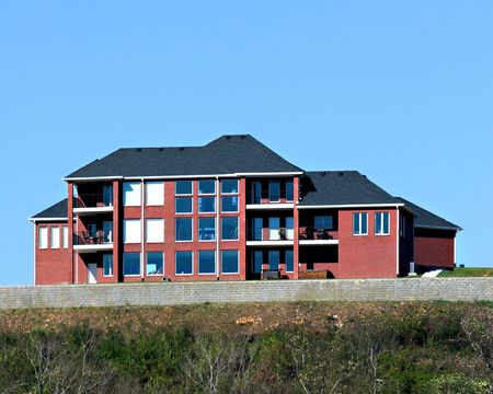 New very large home set on a hill with a view of the city photo