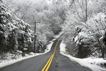 winter road: Hilly country roads,covered with black ice & snow