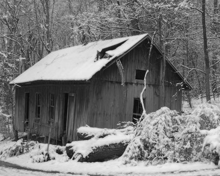 Old country store abandoned, fresh snow has fallen Stock Photo
