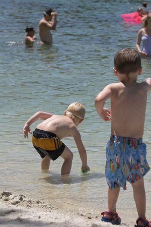 Children swimming & playing at local lake in Florida photo
