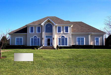 Blue skies, beautiful home in affluent neighborhood Stock Photo