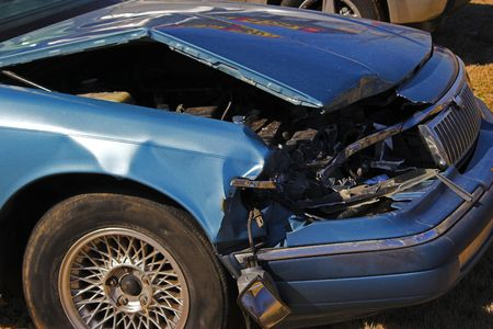 Vehicle  showing front end damage from head-on acccident Stock Photo