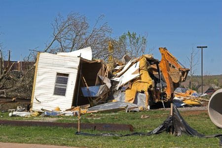 Cold front bringing tornadoes & straight line winds to Tenessee & Kentucky ,this construction office was destroyed by high winds,President Bush Monday to declare Dyer and Gibson Counties federal disaster areas.