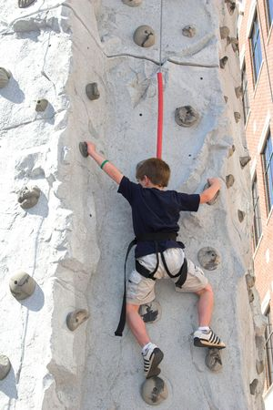 kiddies: Child leaning how to rock climb