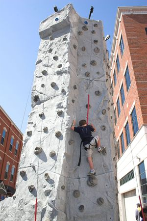 Child leaning how to rock climb photo
