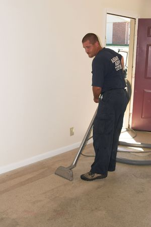 Tech  steam cleaning carpet in apartment Stock Photo