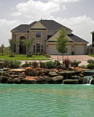 suburban home: New  homes in affluent neighborhood, sales are steady