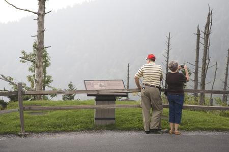 Retired couple enjoying the mountains photo