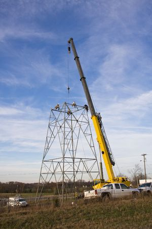 crane parts: Contractors are installing new high voltage transmission towers to carry electricity across the country, parts are lifted with a large crane