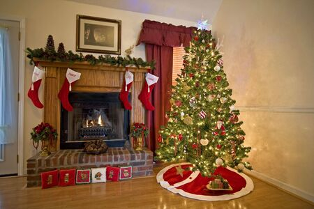 seeting: Home for Chritmas, moms got the house decorated, tree lit up, waiting for santa Stock Photo