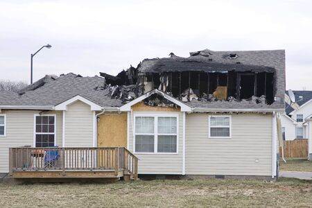 can't: Home caught on fire in the middle of the night, home is a total loss, family had insurance but cant replace memories Stock Photo
