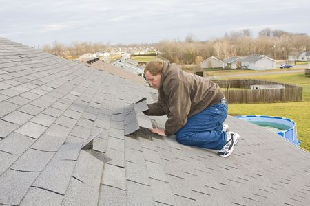 repairs: Strong winds from thunder storms caused damage to homes, damaging roofs and siding, knocking down fences and injuring many people  Stock Photo