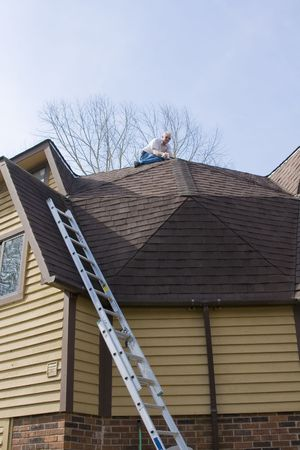damaged roof: Roof inpector check for damage after recent wind storms, many roofs were damaged Stock Photo