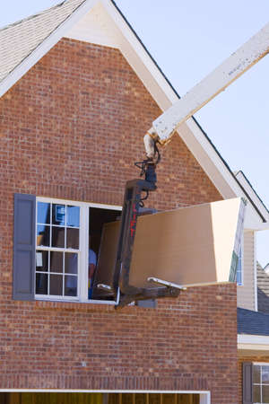 second floor: Truck driver delivering sheet rock to second floor of new home
