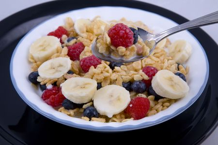 heathy: Bowel of fresh fruit, cereal, good heathy start for the day