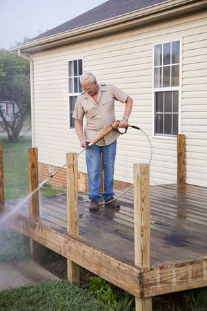 pressure washing: Contractor pressure washing deck , getting home ready to sell