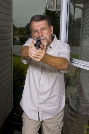 Man with carry permit looking for criminals that have broken into his home, police are on their way Stock Photo