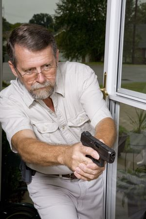 drug bust: Man with carry permit looking for criminals that have broken into his home, police are on their way Stock Photo
