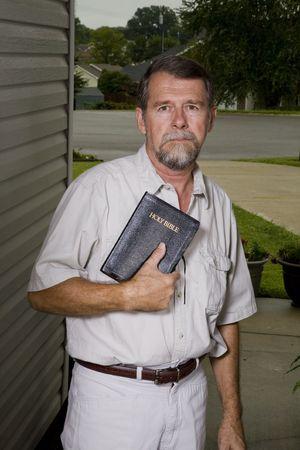 Local church preacher inviting neighbors to hear the gospel